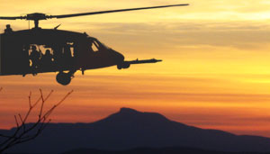 Black Hawk Helicopter with Camel's Hump in the background.